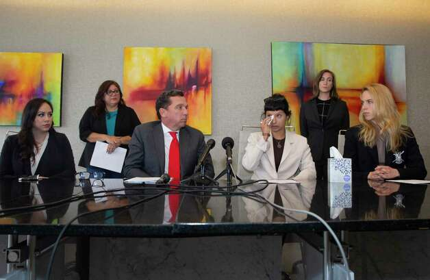 First victim, second right, of the sexual assault allegations against Houston Texans quarterback Desaun Watson gives a statement during a news conference with attorney Tony Buzbee and his legal team Tuesday, April 6, 2021, in Houston. Photo: Yi-Chin Lee, Houston Chronicle / Staff Photographer / © 2021 Houston Chronicle
