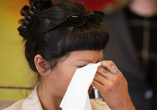 Ashley Solis, the first accusor of the sexual assault allegations against Houston Texans quarterback Desaun Watson, wipes away tears while giving her statement during a news conference Tuesday, April 6, 2021, in Houston. Photo: Yi-Chin Lee, Houston Chronicle / Staff Photographer / © 2021 Houston Chronicle