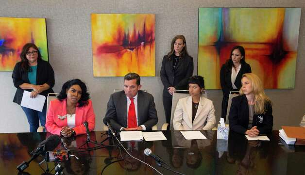 Ashley Solis, second right, the first accusor of the sexual assault allegations against Houston Texans quarterback Desaun Watson, gives her statement during a news conference Tuesday, April 6, 2021, in Houston. Solis was acompanied by attorney Tony Buzbee, his legal team and experts. Photo: Yi-Chin Lee, Houston Chronicle / Staff Photographer / © 2021 Houston Chronicle