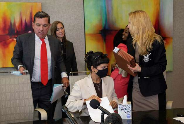Ashley Solis, the first accusor of the sexual assault allegations against Houston Texans quarterback Desaun Watson, gets up to leave following a news conference Tuesday, April 6, 2021, in Houston. Photo: Yi-Chin Lee, Houston Chronicle / Staff Photographer / © 2021 Houston Chronicle