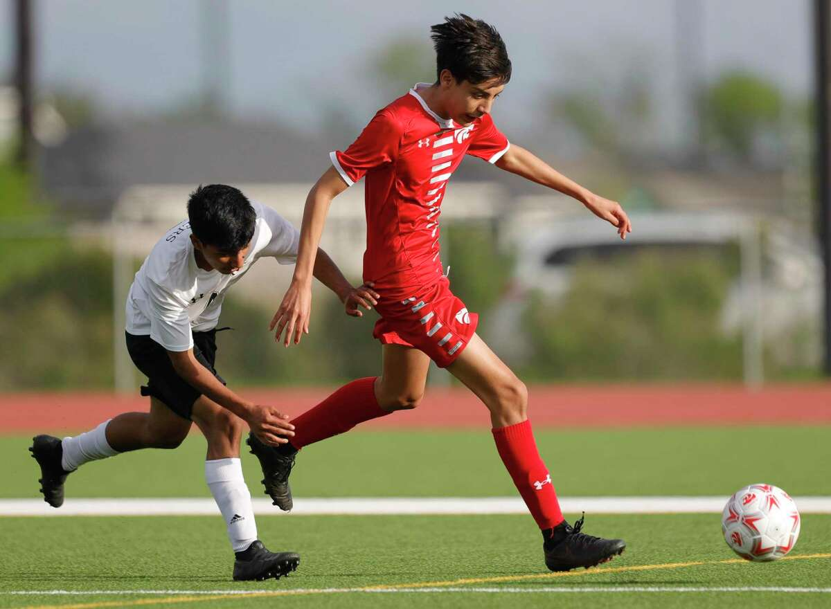 Splendora's Baruc Delgado (10) dribbles the ball during the first period of a Region III-4A semifinal match at Cypress Park High School, Tuesday, April 6, 2021, in Cypress.