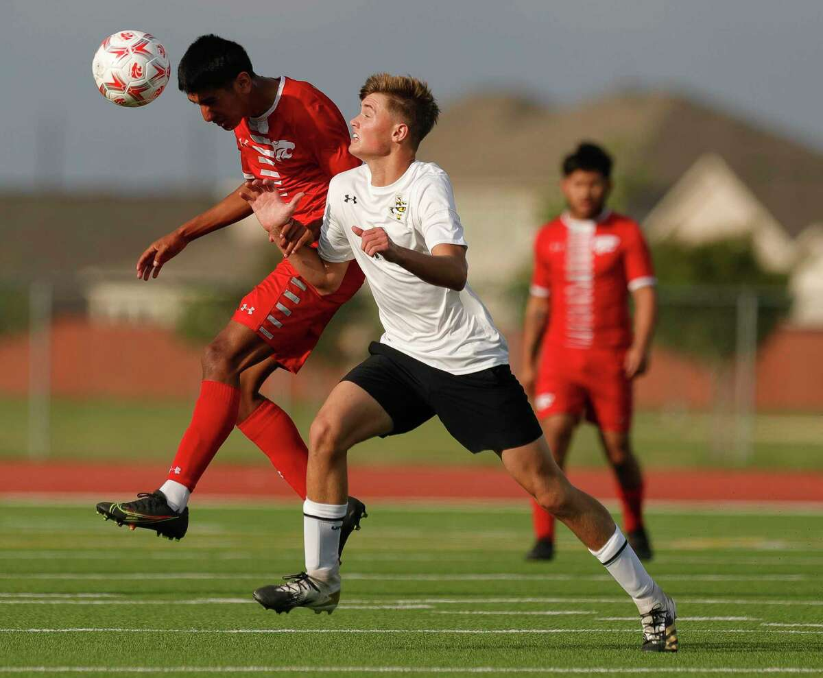 Splendora's Fabian Artega (12) heads the ball during the first period of a Region III-4A semifinal match at Cypress Park High School, Tuesday, April 6, 2021, in Cypress.