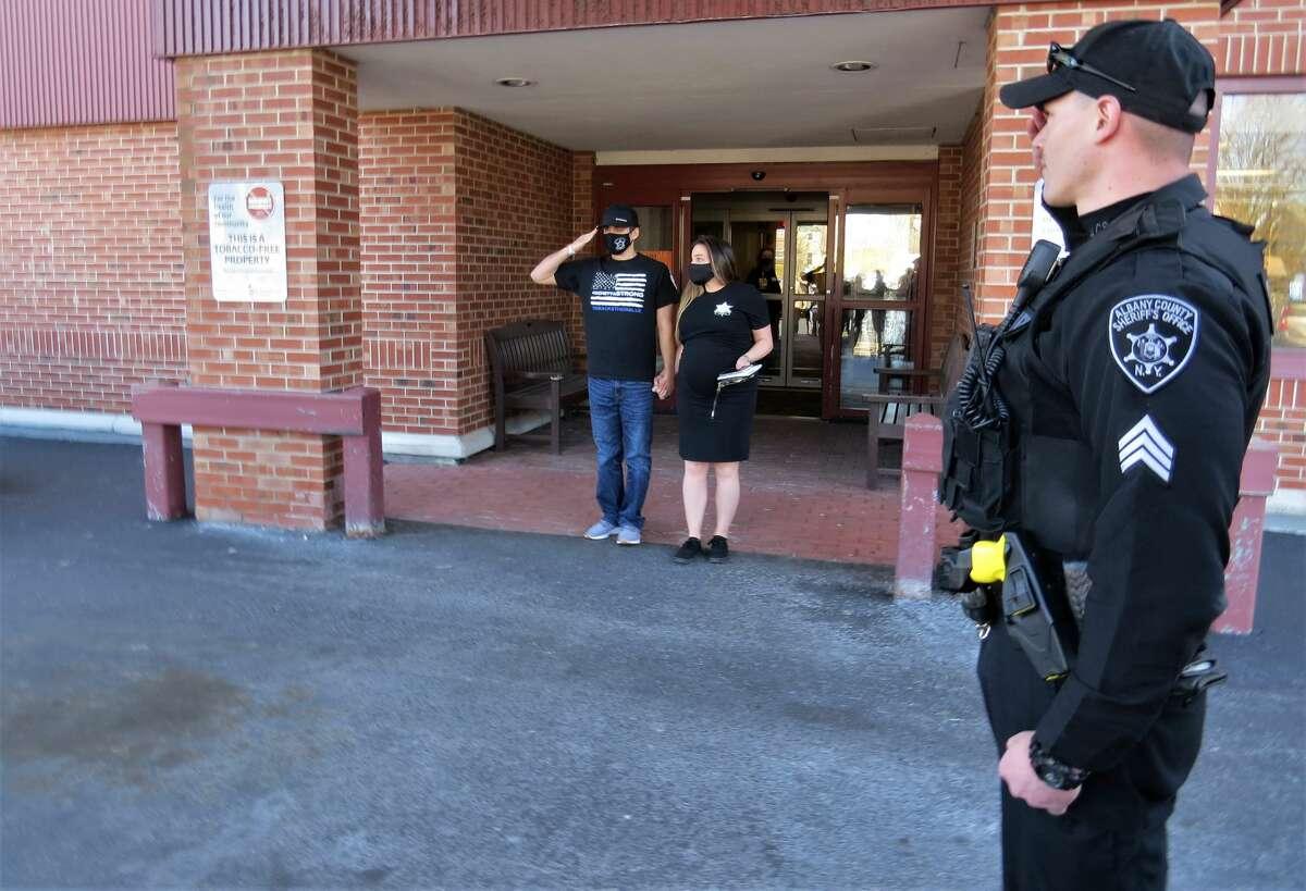Sgt. Joseph Iachetta and his wife Sarah walk out of Sunnyview Rehabilitation Hospital on Tuesday April 6, 2021.