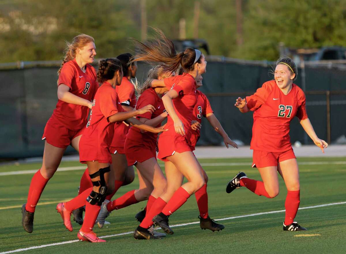 FILE - The Woodlands defender Rylie Graves (27) and her teammates after after they score a goal during the second half of a Region II-6A quarterfinals soccer match against Tomball at Woodforest Bank Stadium, Friday, April 2, 2021, in The Woodlands.