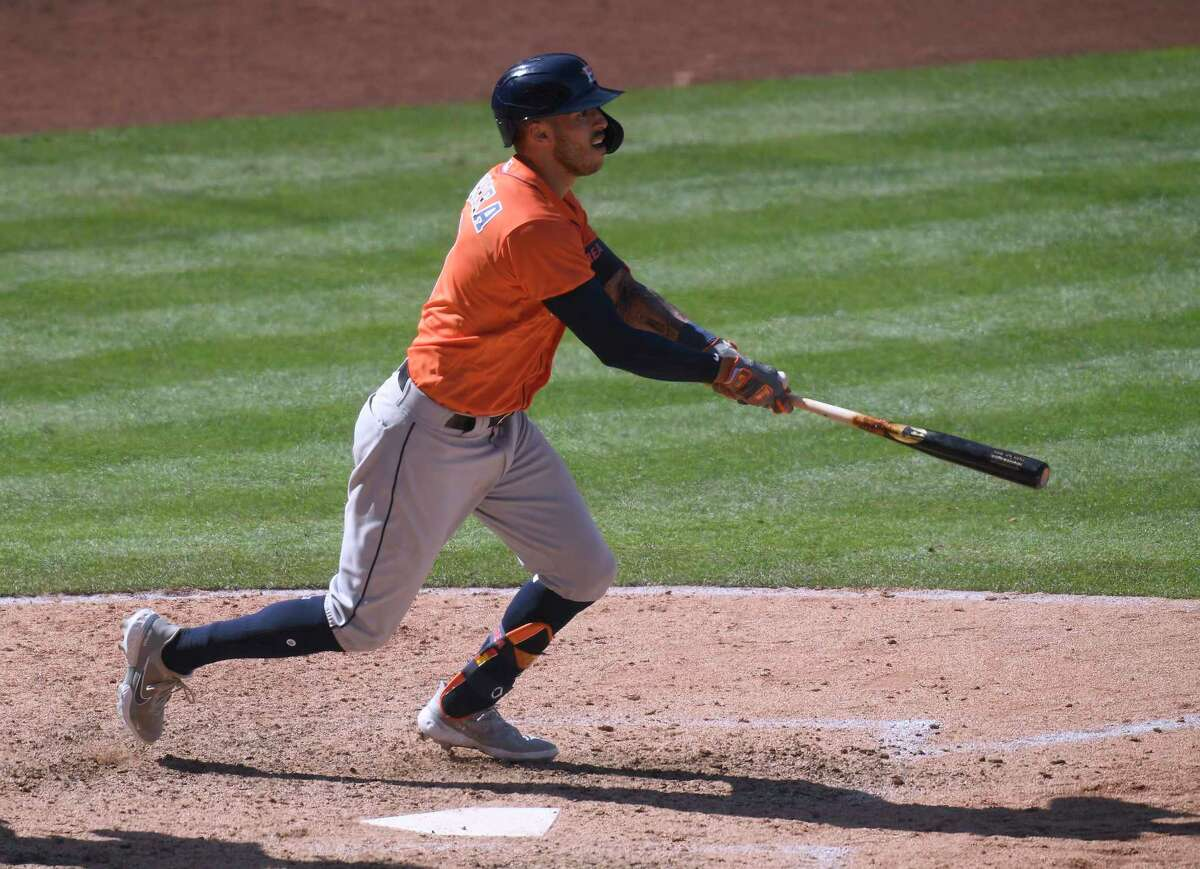 Carlos Correa of the Houston Astros hits a two-run home run against the Los Angeles Angels during the 10th inning at Angel Stadium of Anaheim on Tuesday, April 6, 2021, in Anaheim, California.