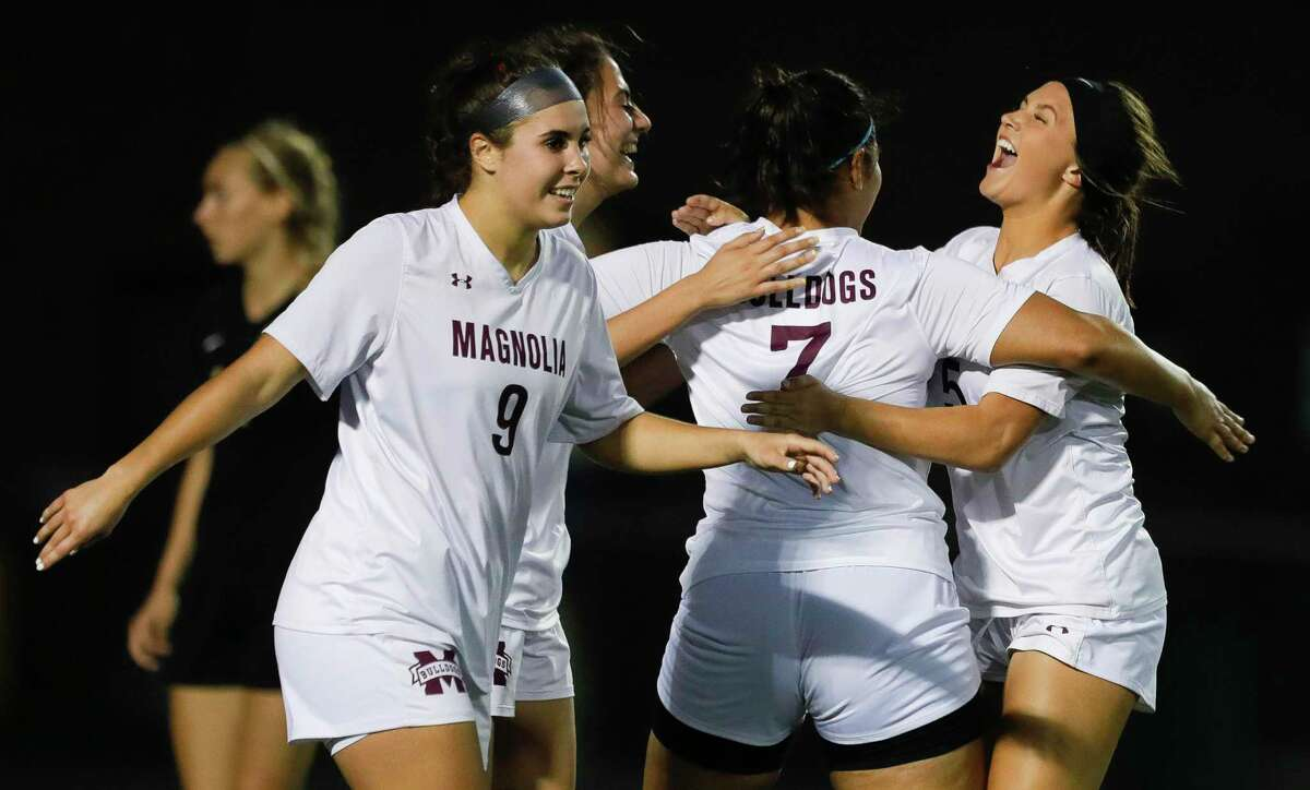 Magnolia players celebrate after Gaby Palomino's second goal of match gave the Lady Bulldogs a 2-0 advantage in the second period of a Region III-5A semifinal match at Cypress Falls High School, Tuesday, April 6, 2021, in Cypress.