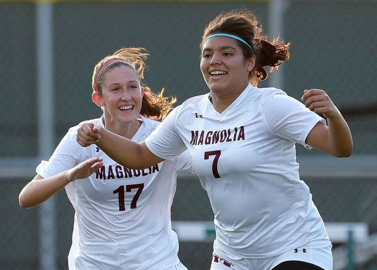 Magnolia's Gaby Palomino (7) reacts beside Sara Gianotti (17) after scoring a goal during the first period of a Region III-5A semifinal match at Cypress Falls High School, Tuesday, April 6, 2021, in Cypress.