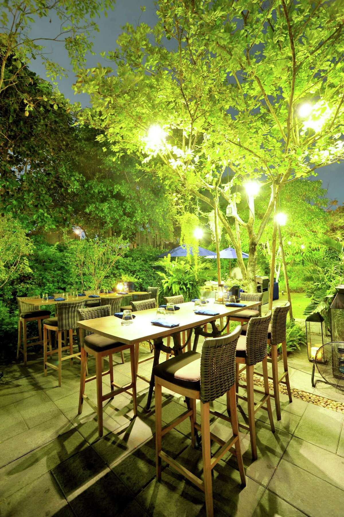 Outdoor chandeliers and hanging lights make the patio look romantic.