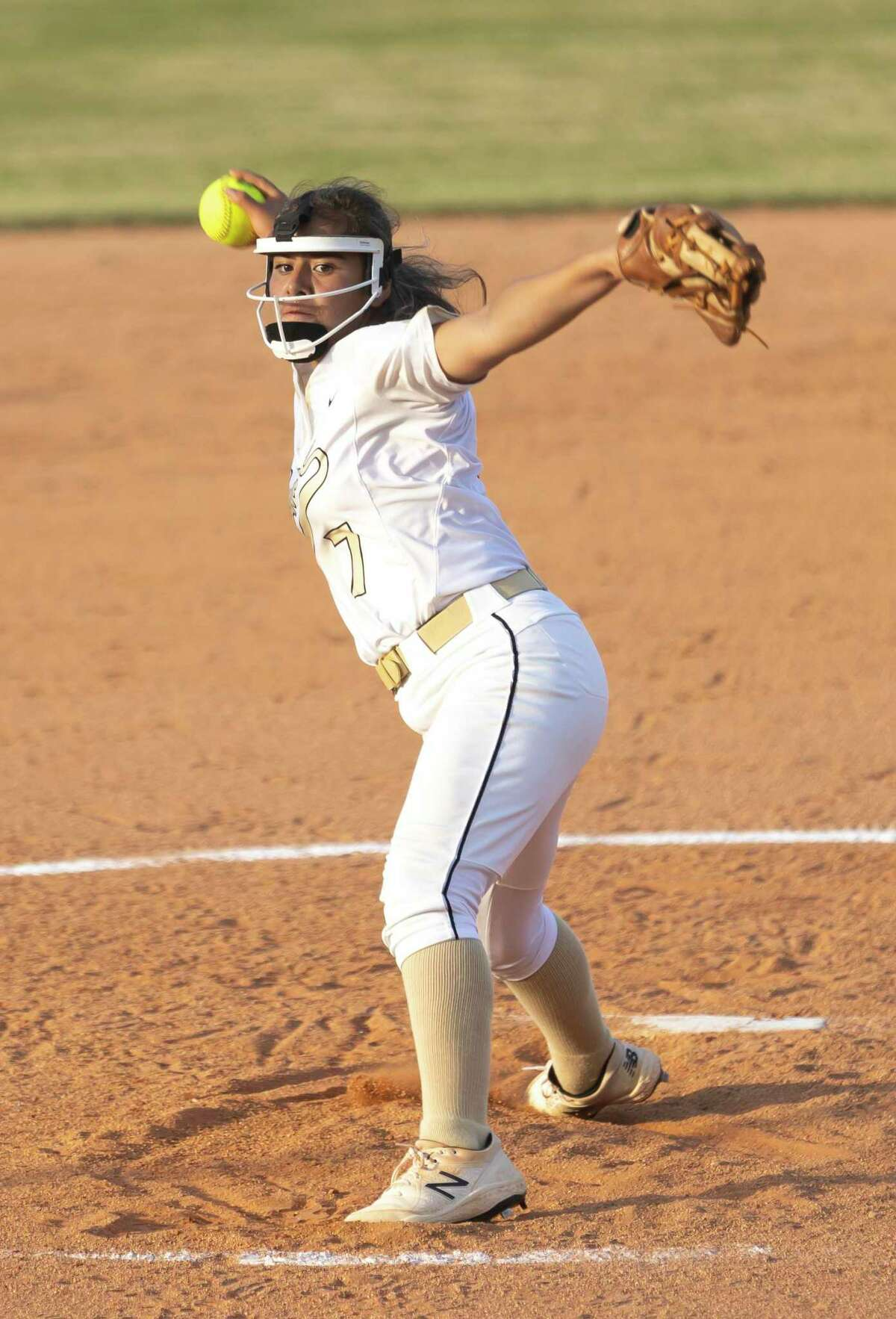 Conroe pitcher Izzy Lozada (7) pitches during the third inning of a District 13-6A softball game against Willis at Conroe High School on Tuesday, April 6, 2021, in Conroe.