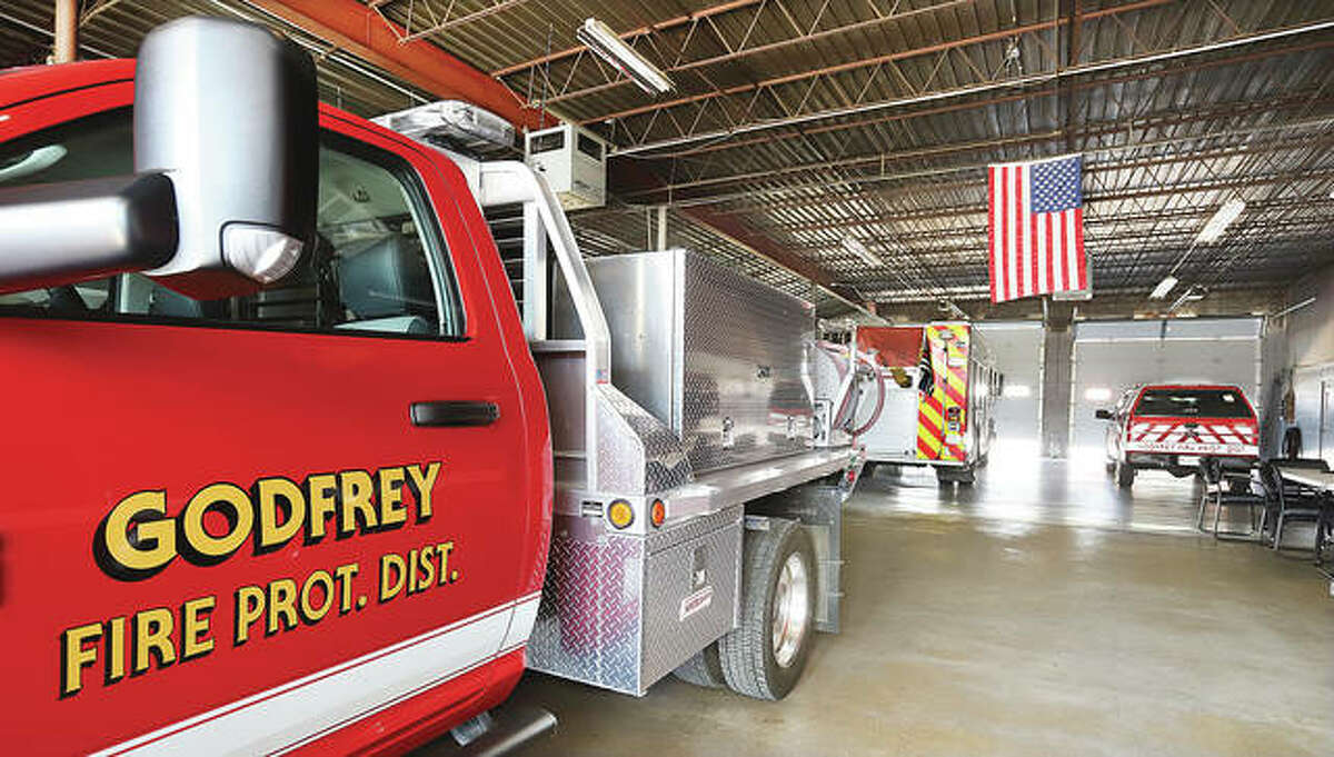 Trucks stand at the ready inside Godfrey Fire Station 1 on Godfrey Road. Voters overwhelmingly supported a referendum to issue bonds for a new central fire station and fund new firefighter equipment, including vehicles.