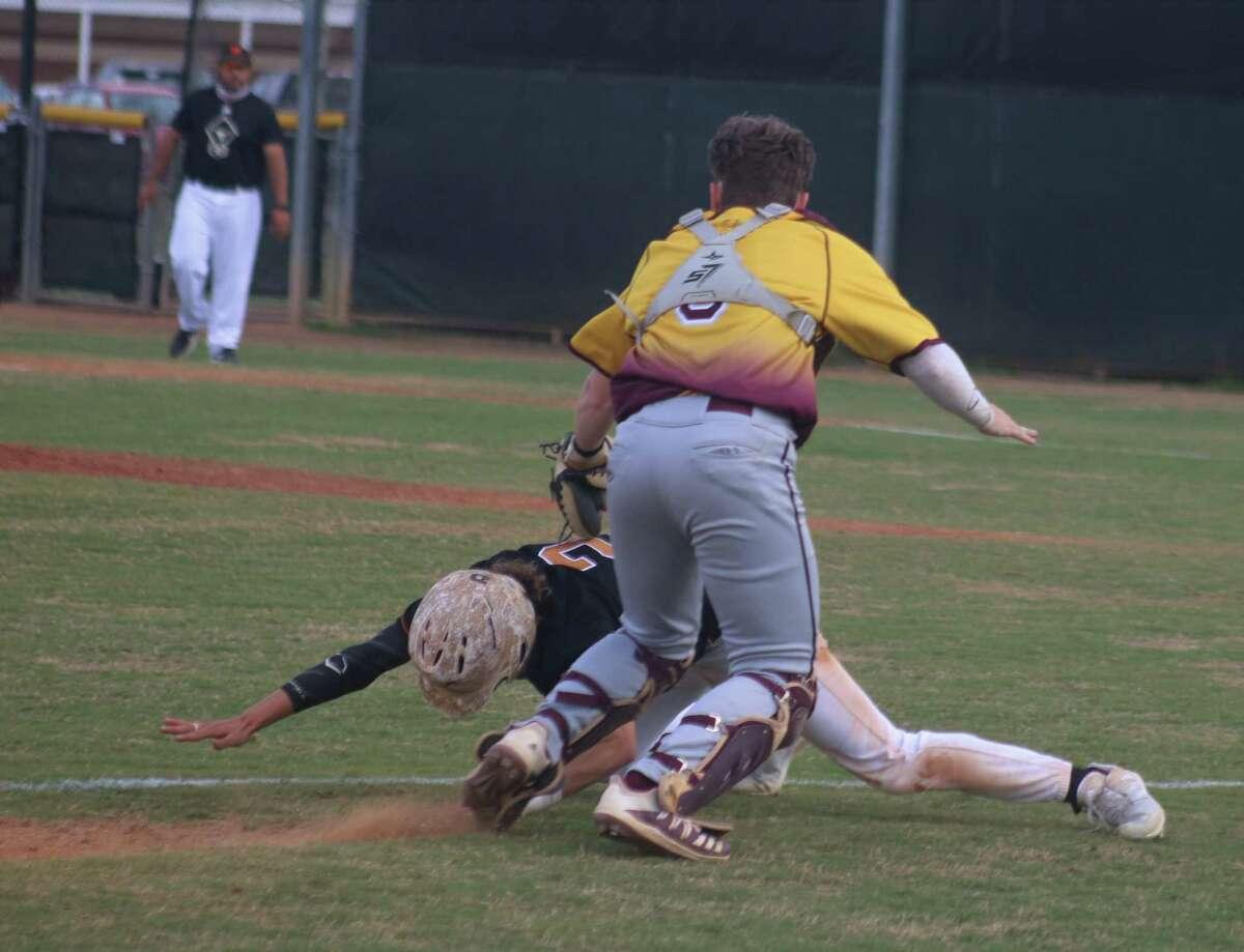 Deer Park catcher Tanner Phillips completes the successful rundown for the first out of the third inning.