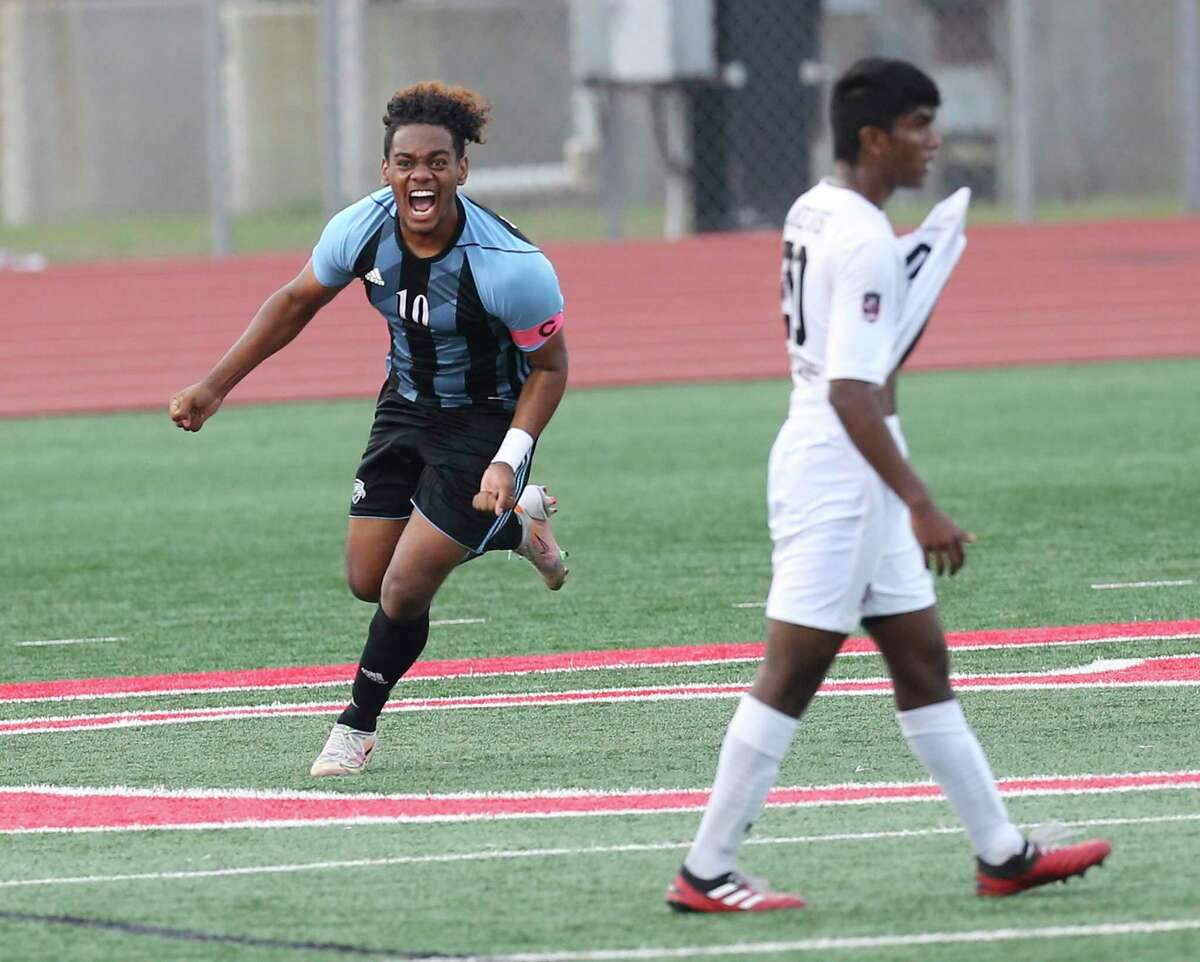 Harlan's Cameron Burleson (10) reacts after scoring early in the first half against Lake Travis during their Region IV-6A semifinal boys soccer game in New Braunfels on Tuesday, Apr. 6, 2021. Harlan ended their playoff run losing to Lake Travis, 2-1.