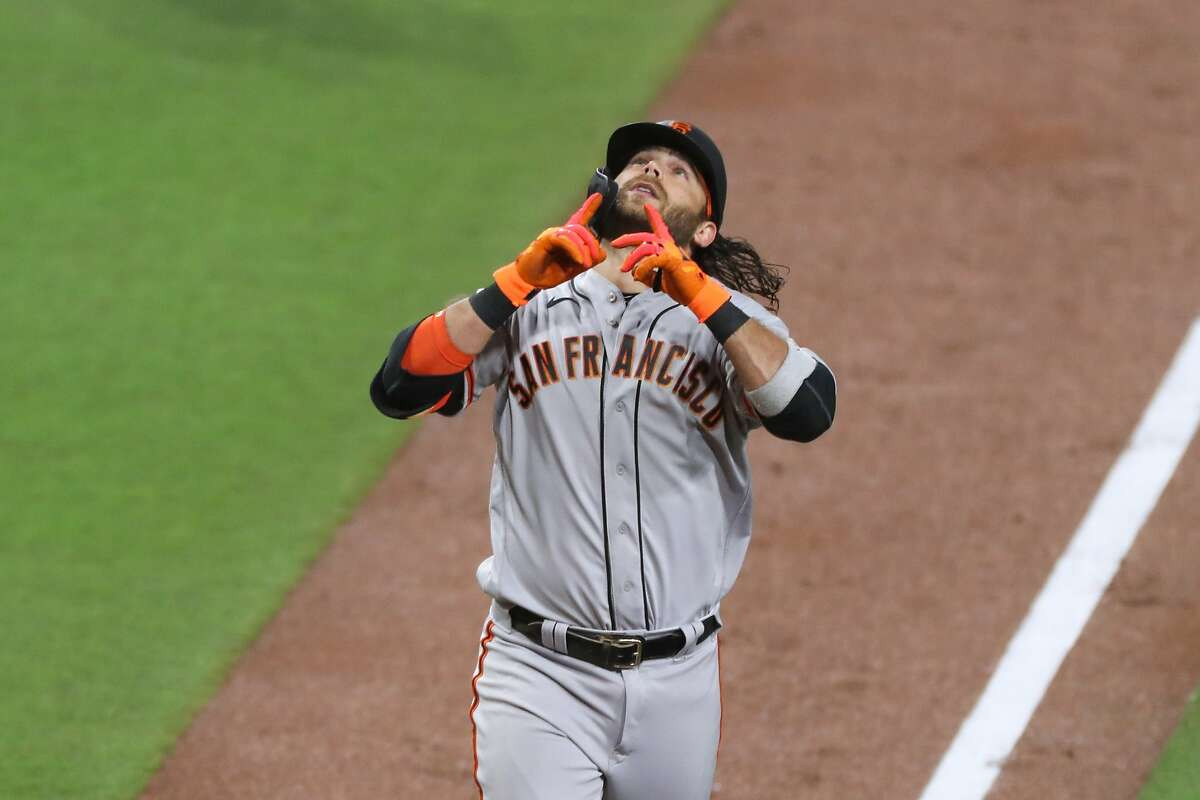 San Francisco Giants Brandon Crawford jesters to the sky after hitting a solo home run against the San Diego Padres in the in third inning of a baseball game Tuesday, April 6, 2021, in San Diego. (AP Photo/Derrick Tuskan)