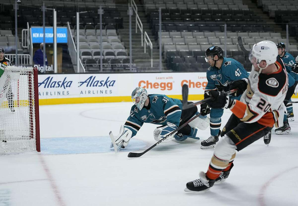 Anaheim left wing Nicolas Deslauriers (right) gets the puck past Sharks goaltender Martin Jones during the second period, when the Ducks scored three times in their win.