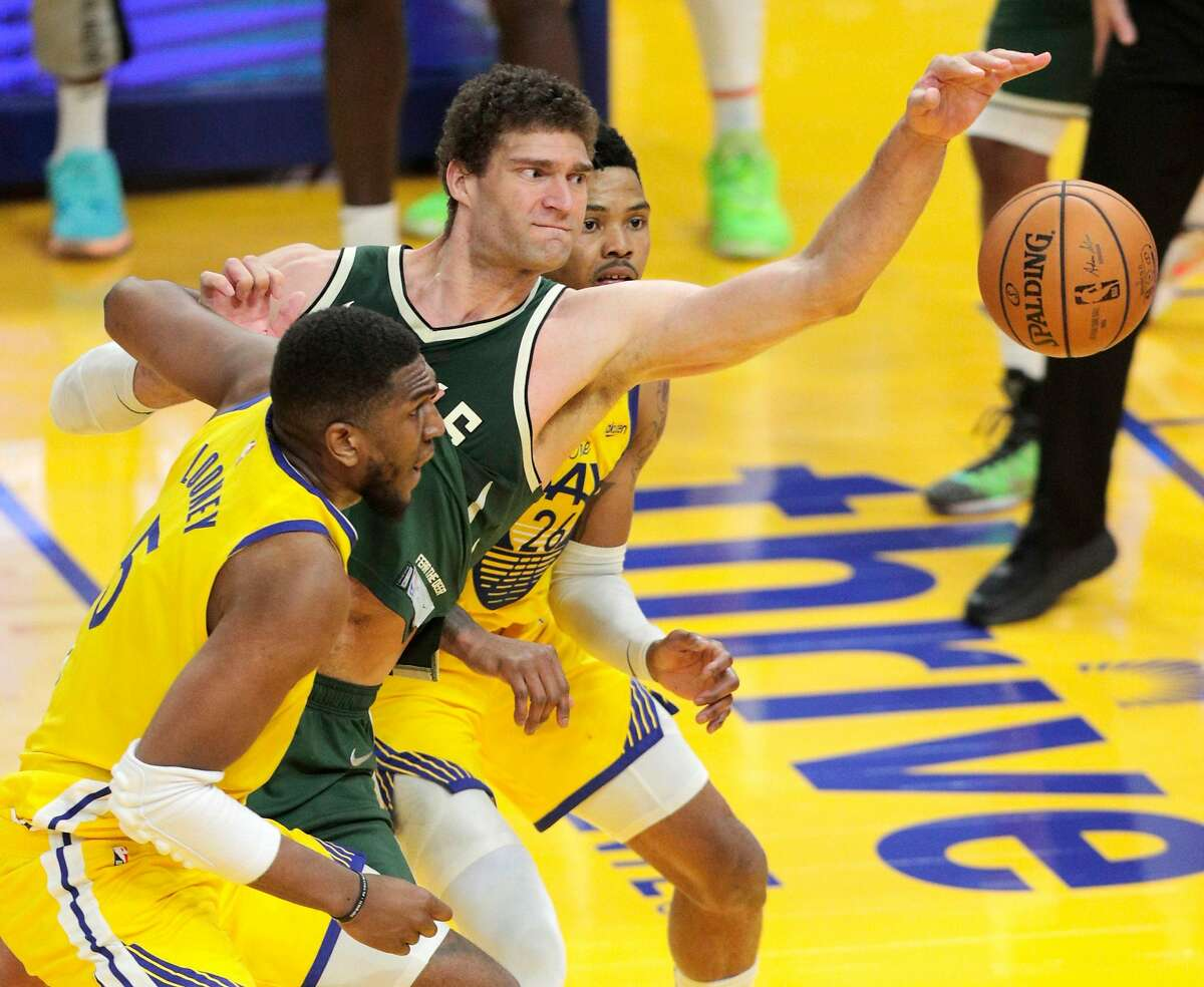 Brook Lopez (11) tries to grab the rebound after the Bucks' final shot failed to go in in the second half as the Golden State Warriors defeated the Milwaukee Bucks 122-121 at Chase Center in San Francisco Calif., on Tuesday, April 6, 2021.