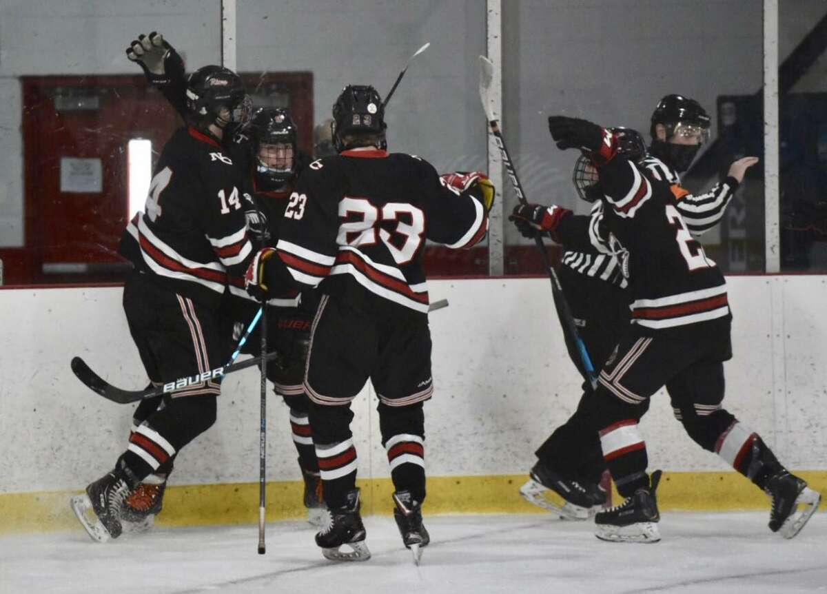 New Canaan celebrates a first-period goal against Greenwich during the FCIAC boys ice hockey final at Hamill Rink in Greenwich on Saturday.