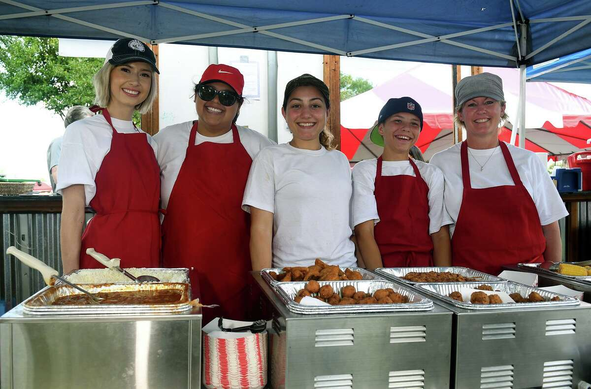 Gabrielle Kasten, from left, Micaela Flores, Brooke Fotech, Trentin Mathis, 15, and Kimberly Walz team-up at the French Quarter Cajun Seafood Restaurant (in Cy-Fair) booth during the Tomball 7th Annual Rails & Tails Mudbug Festival at the Tomball Depot on May 5, 2018. (Photo by Jerry Baker/Freelance)
