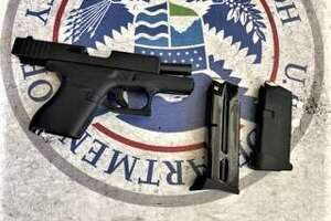 A Sherman man was allegedly caught with a loaded handgun in his carry-on bag Tuesday, according to the Transportation Safety Administration.