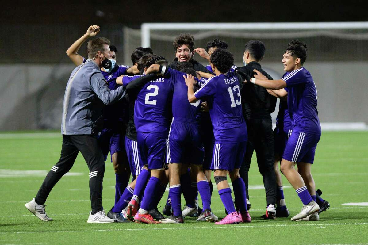 The Jersey Village Falcons celebrate after their 2-1 victory over the Elsik Rams in a 6A-III regional semifinal soccer match on Tuesday, April 6, 2021 at Legacy Stadium, Katy, TX.