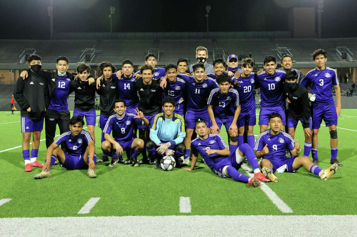 The Jersey Village Falcons celebrate their 2-1 victory over the Elsik Rams in a 6A-III regional semifinal soccer match on Tuesday, April 6, 2021 at Legacy Stadium, Katy, TX.