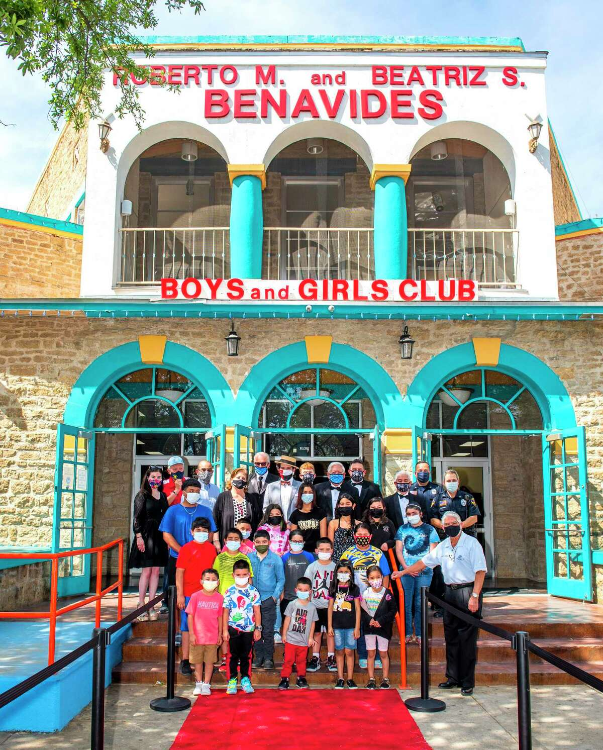The Boys & Girls Club of Laredo board members, staff and Laredo Police officers welcome children back to the Benavides Boys & Girls Club, Tuesday, Apr. 6, 2021, during a grand reopening red carpet event.