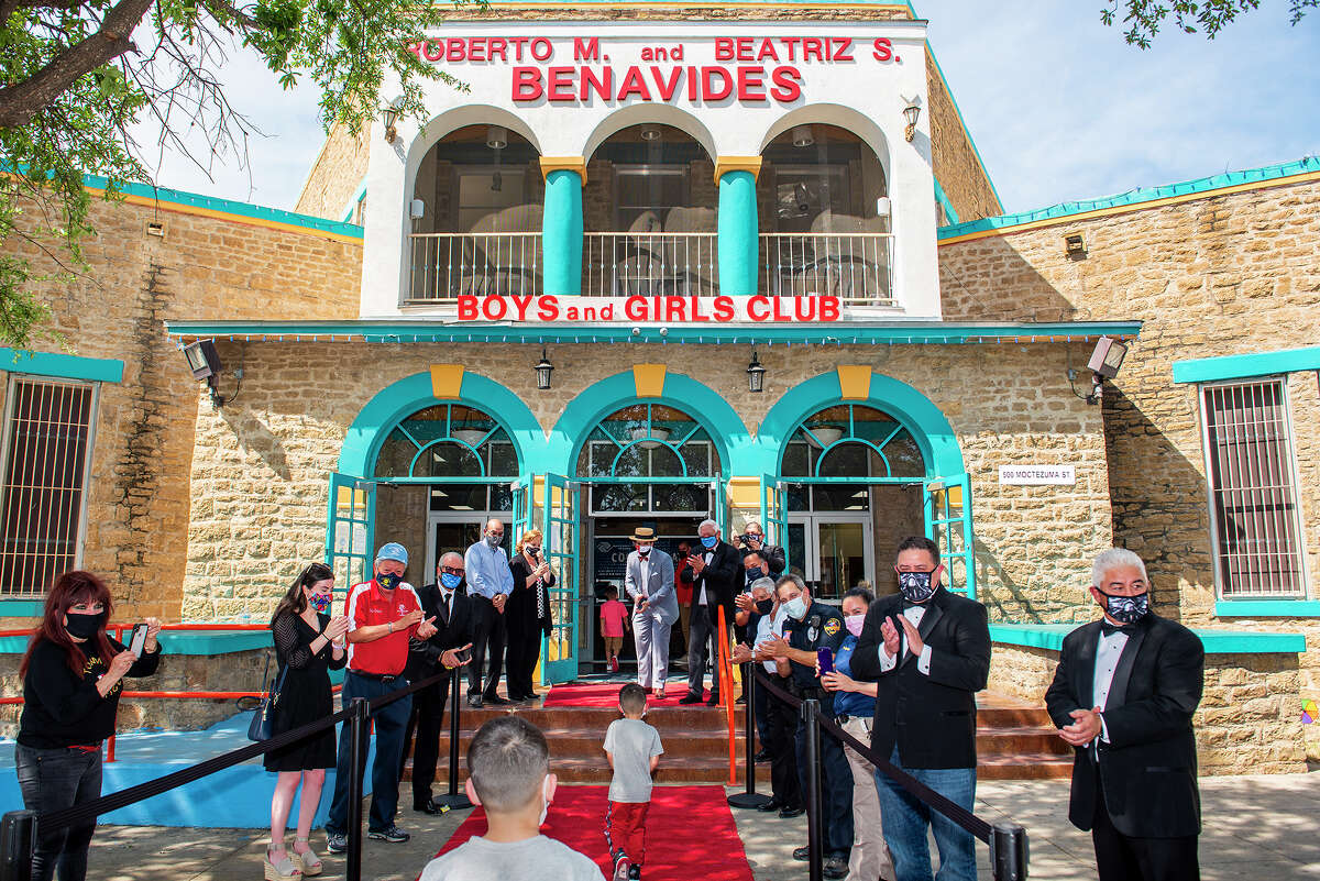 The Boys and Girls Club of Laredo board members, staff and Laredo Police officers welcome children back to the Benavides Boys and Girls Club, Tuesday, Apr. 6, 2021, during a grand reopening red carpet event.