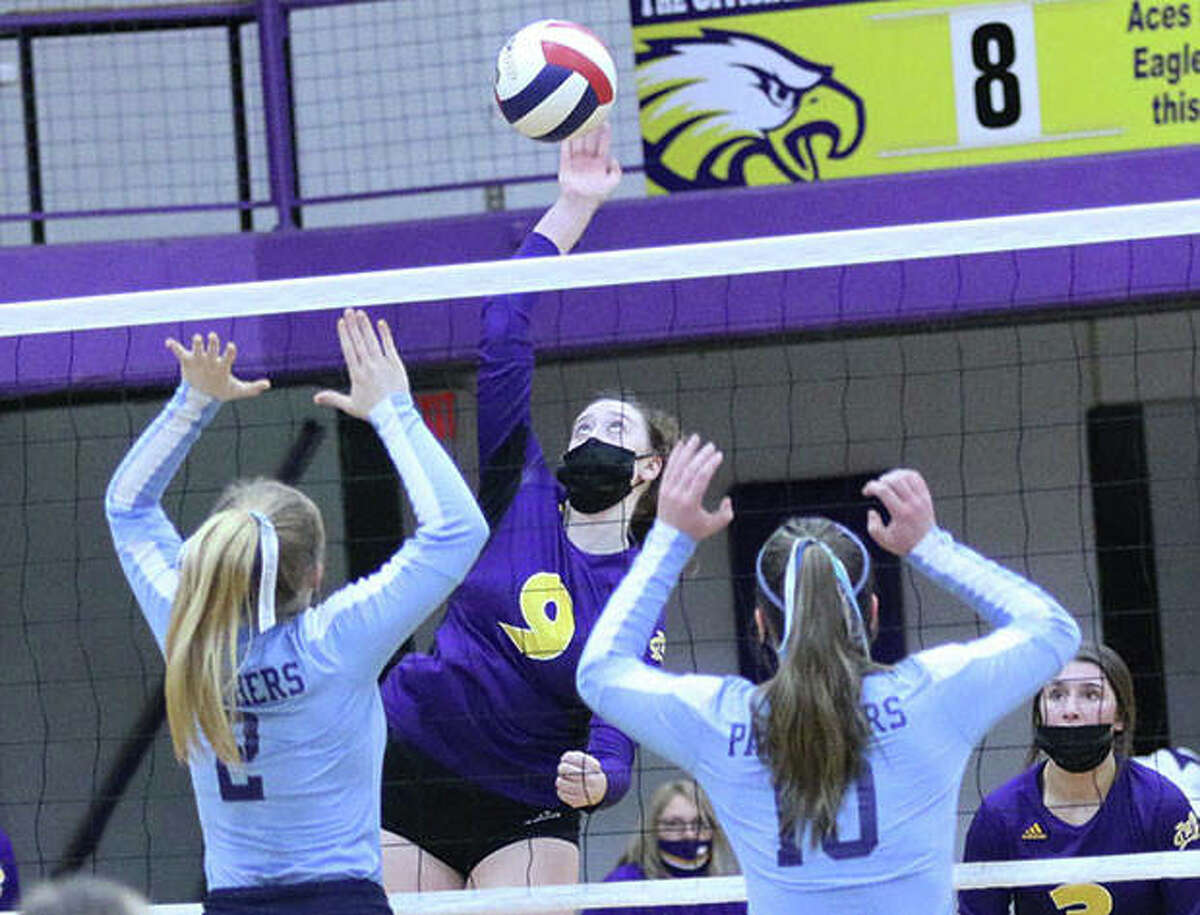 CM's Lauren Dunlap (9) attacks before Jersey's Sally Hudson and Caroline Gibson (10) can put up a block in a March 18 volleyball match in Bethalto. The teams met again Tuesday night in Jerseyville, with CM completing a Valley sweep against the Panthers.