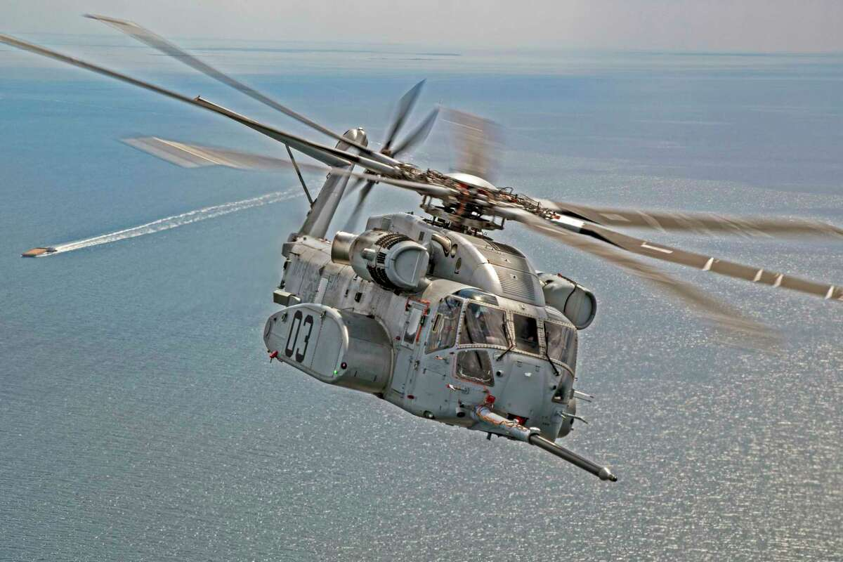 A pilot maneuvers Sikorsky's new CH-53K King Stallion helicopter in early April 2020, over Chesapeake Bay during flight tests for aerial refueling.