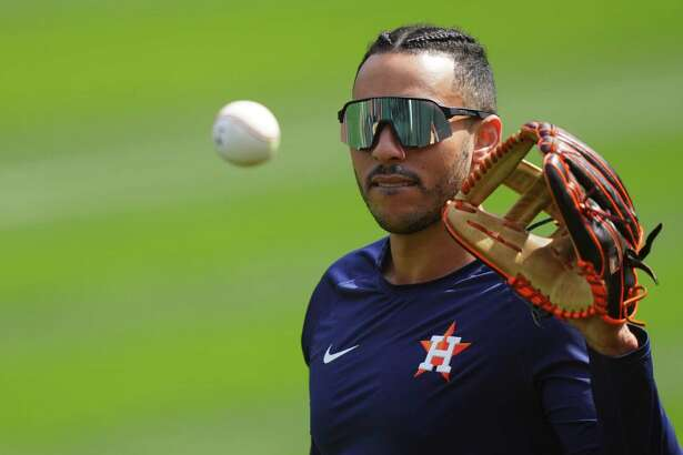 OAKLAND, CALIFORNIA - APRIL 04: Carlos Correa #1 of the Houston Astros warms up prior to the game against the Oakland Athletics at RingCentral Coliseum on April 04, 2021 in Oakland, California.