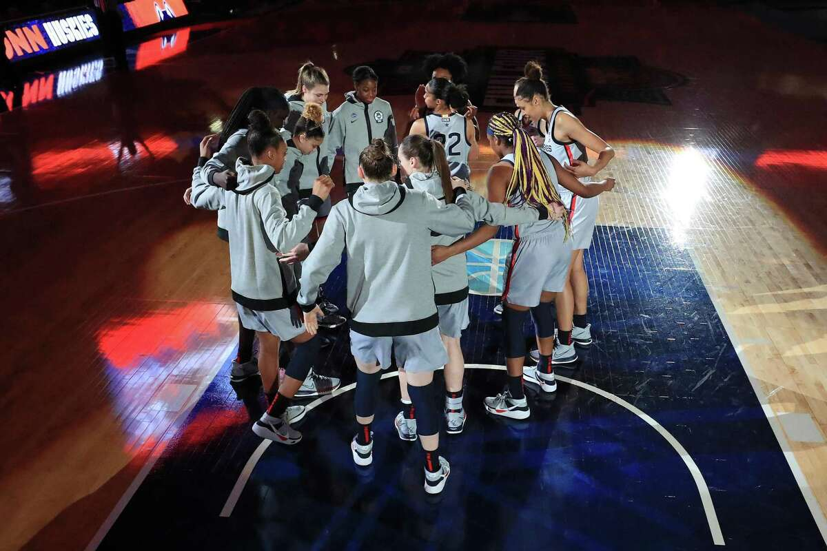 The UConn Huskies huddle up during intros prior to the first quarter against the Arizona Wildcats in the Final Four semifinal game of the 2021 NCAA Women's Basketball Tournament at the Alamodome on April 02, 2021 in San Antonio, Texas.