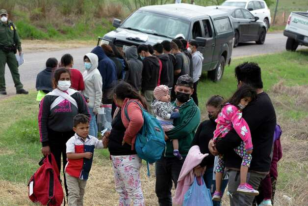 A group of migrants in La Joya wait to be processed by border patrol. Photo: Jessica Phelps / ©2021 San Antonio Express-News