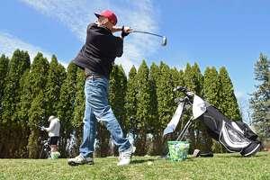 Nicholas Brignola of Brunswick practices his golf swing at the Rte. Fore Golf Center driving range on Wednesday, April 7, 2021 in North Greenbush, N.Y.  (Lori Van Buren/Times Union)