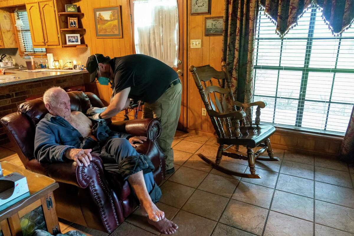 Chambers County paramedic Danny Burke administers a second dose of the Moderna COVID-19 vaccine to Guerry Hahn, 92, on Tuesday, April 6, 2021, in Anahuac, TX. Hahn was receiving the vaccine at the same time as his daughter, who is his caretaker, as part of the county's mobile vaccination program. Hahn got sick with Covid earlier in the pandemic, but weathered the virus without any serious complications.