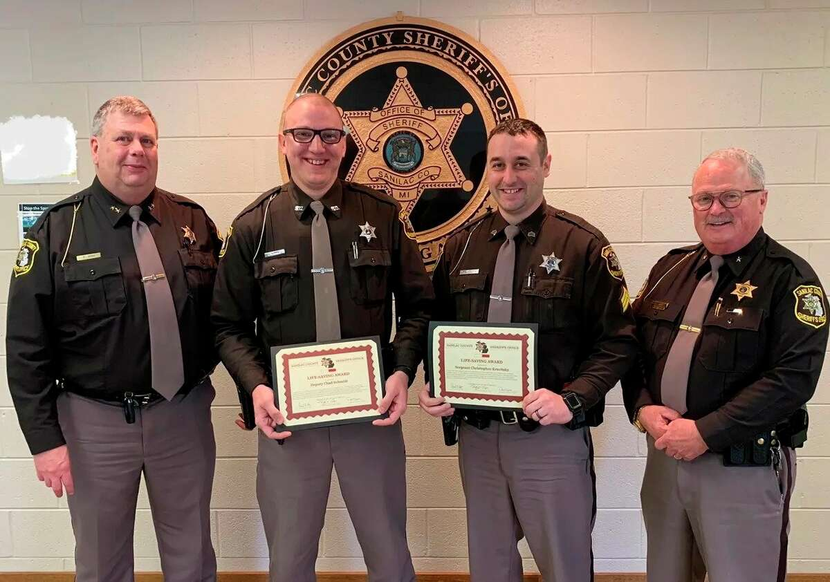 From left, Sanilac County Sheriff Paul Rich, Dept. Chad Schmidt, Dept. Christopher Kravitsky, and Undersheriff Tim Torp as the two deputies receive Commendation for Life Saving awards. Schmidt had received two of these awards in the space of a week. (Sanilac County Sheriff's Office/Courtesy Photo)