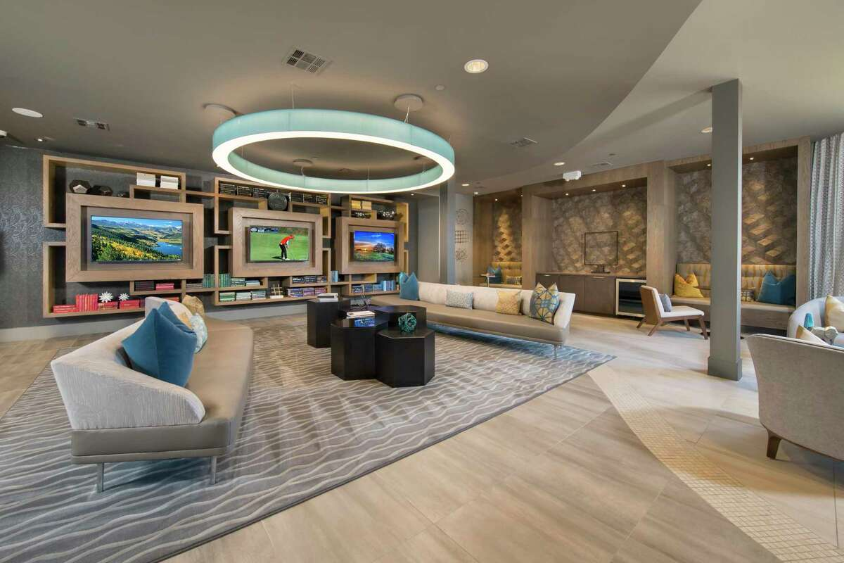 The clubroom is pictured at The Mark at CityPlace Springwoods Village, a development of Martin Fein Interests at 1600 Springwoods Plaza Drive in Spring. CDC Houston acquired the property.