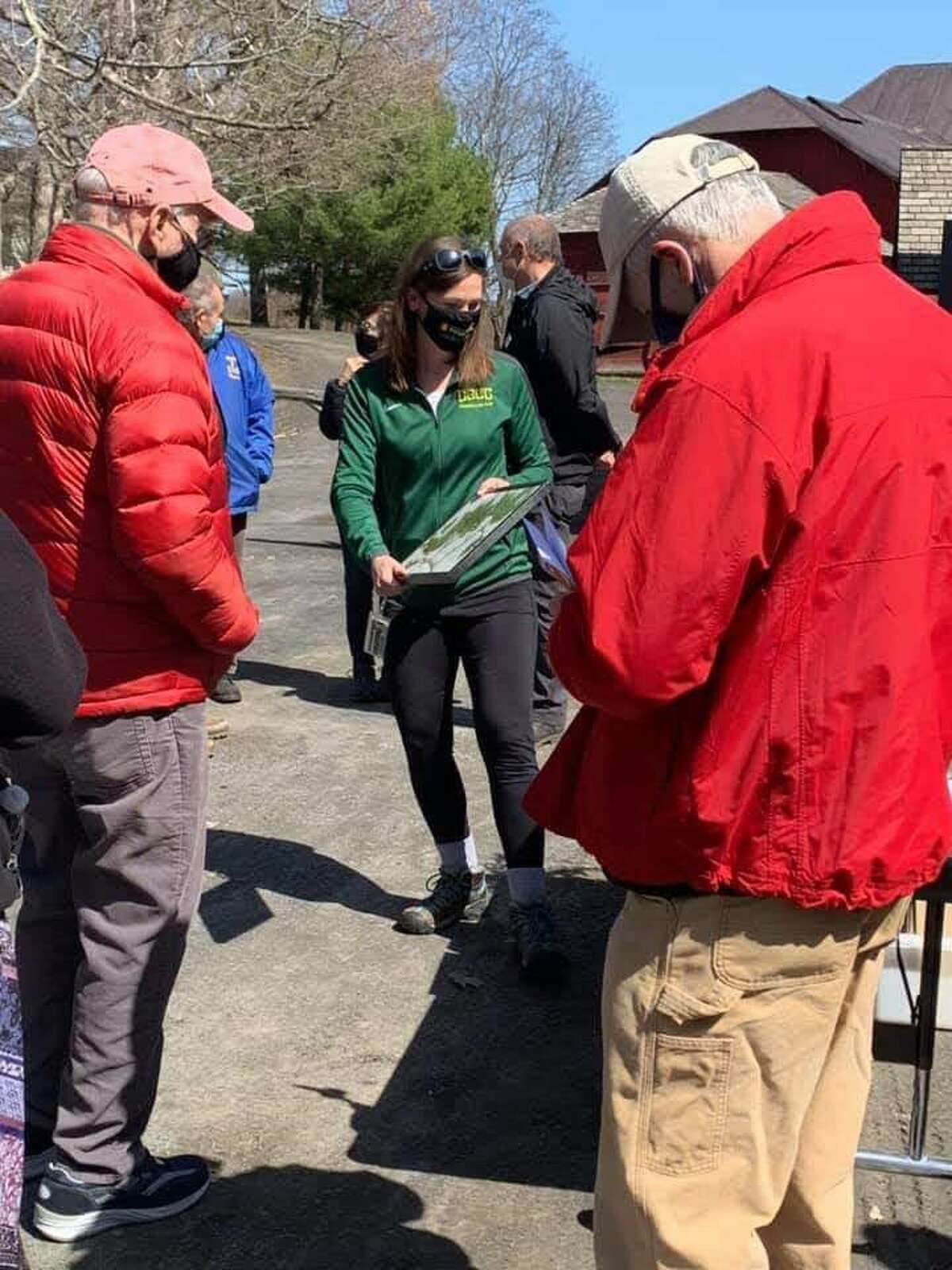 """Columbia-Greene Community College biology Professor Rebecca Pinder, Ph.D., prepares a group of local residents for a walking tour of Olana's hemlocks. Participants who joined Pinder on the walk were invited to locate hemlocks on the Hudson River landmark's property and take part in a """"tree mapping project"""" by the artist Jean Shin. Shin's The'Fallen' art exhibition, celebrating the ecological importance and historical significance of hemlock trees, opens at Olana on May 1 and will be on view through Oct. 31."""