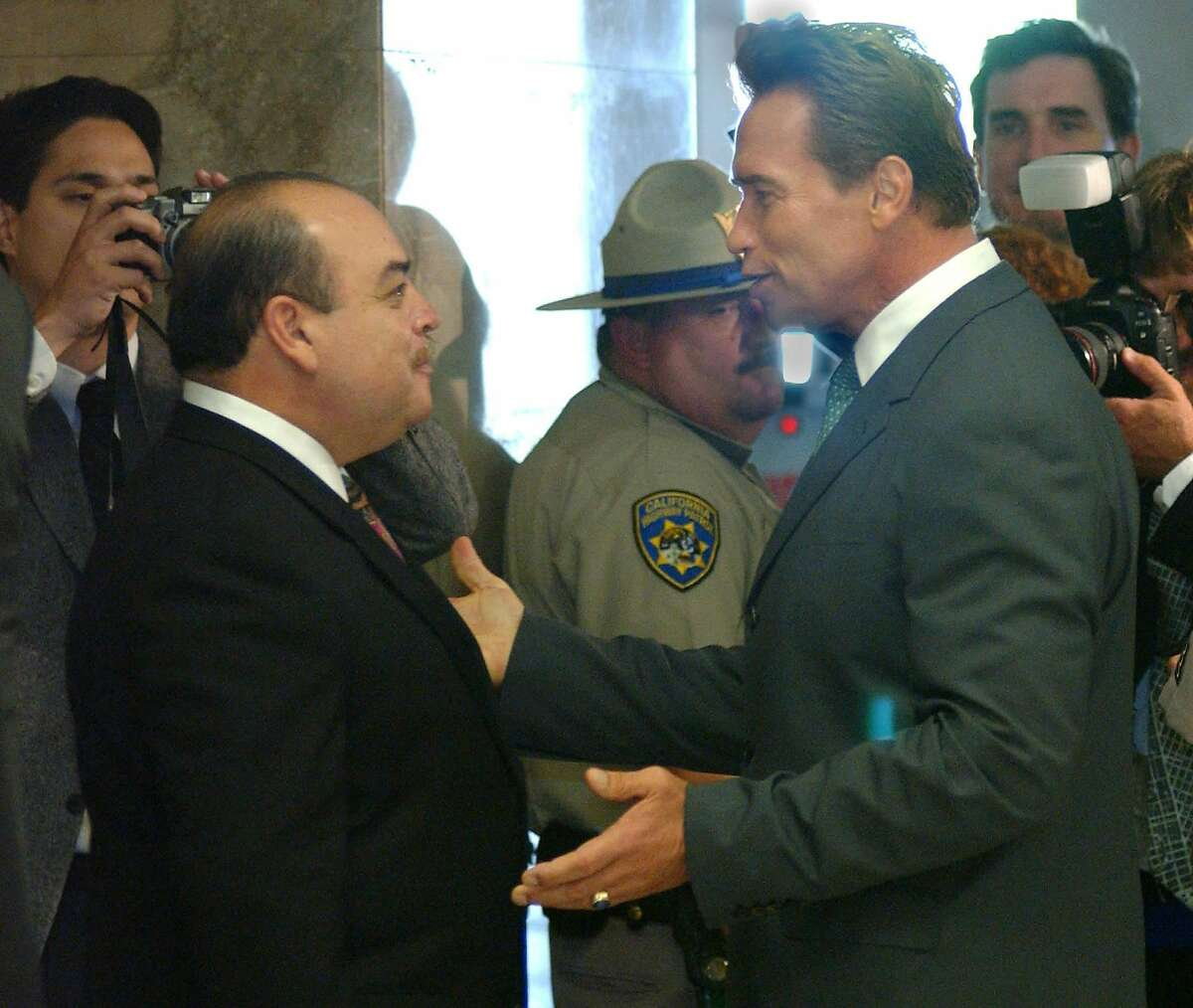 Lt. Gov. Cruz Bustamante (left) talks with Gov.-elect Arnold Schwarzenegger in October 2003 after state voters recalled Gov. Gray Davis. Bustamante ran unsuccessfully as a replacement candidate.