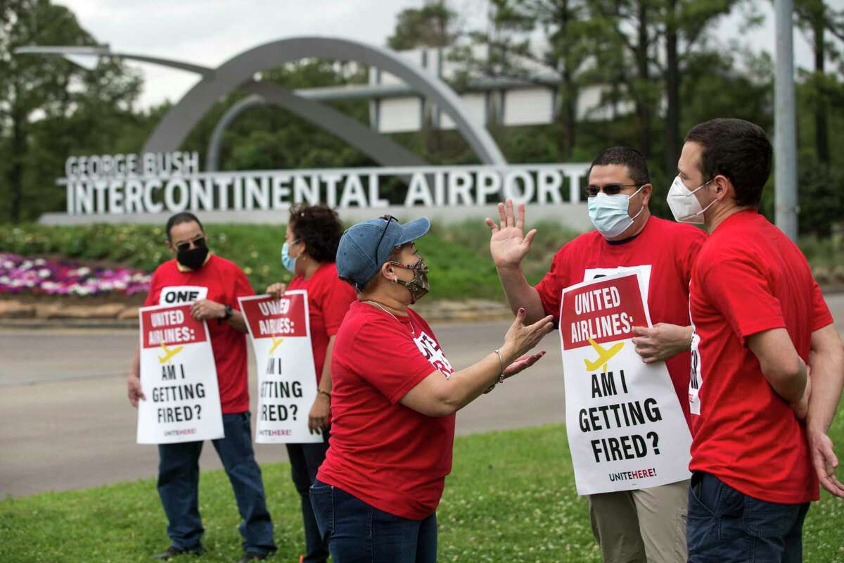 United Airlines catering workers picket at the entrance to George Bush Intercontinental Airport Wednesday, April 7, 2021 in Houston, to protest the airline's plans to outsource the 2,500 jobs despite receiving some $7.7 billion in federal bailout money.