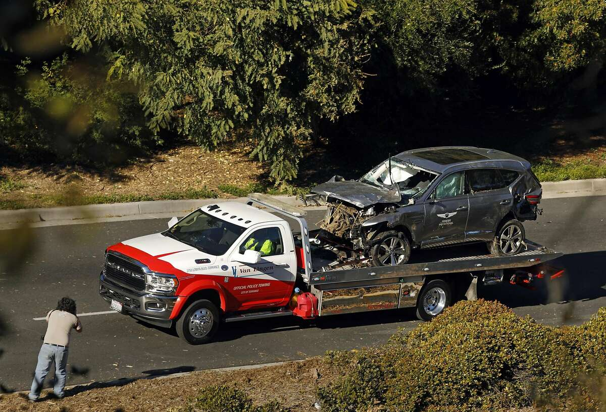 The vehicle driven by Tiger Woods is towed away on Hawthorne Boulevard after he ran off the road and sustained injuries, on Tuesday, Feb. 23, 2021. (Carolyn Cole/Los Angeles Times/TNS)