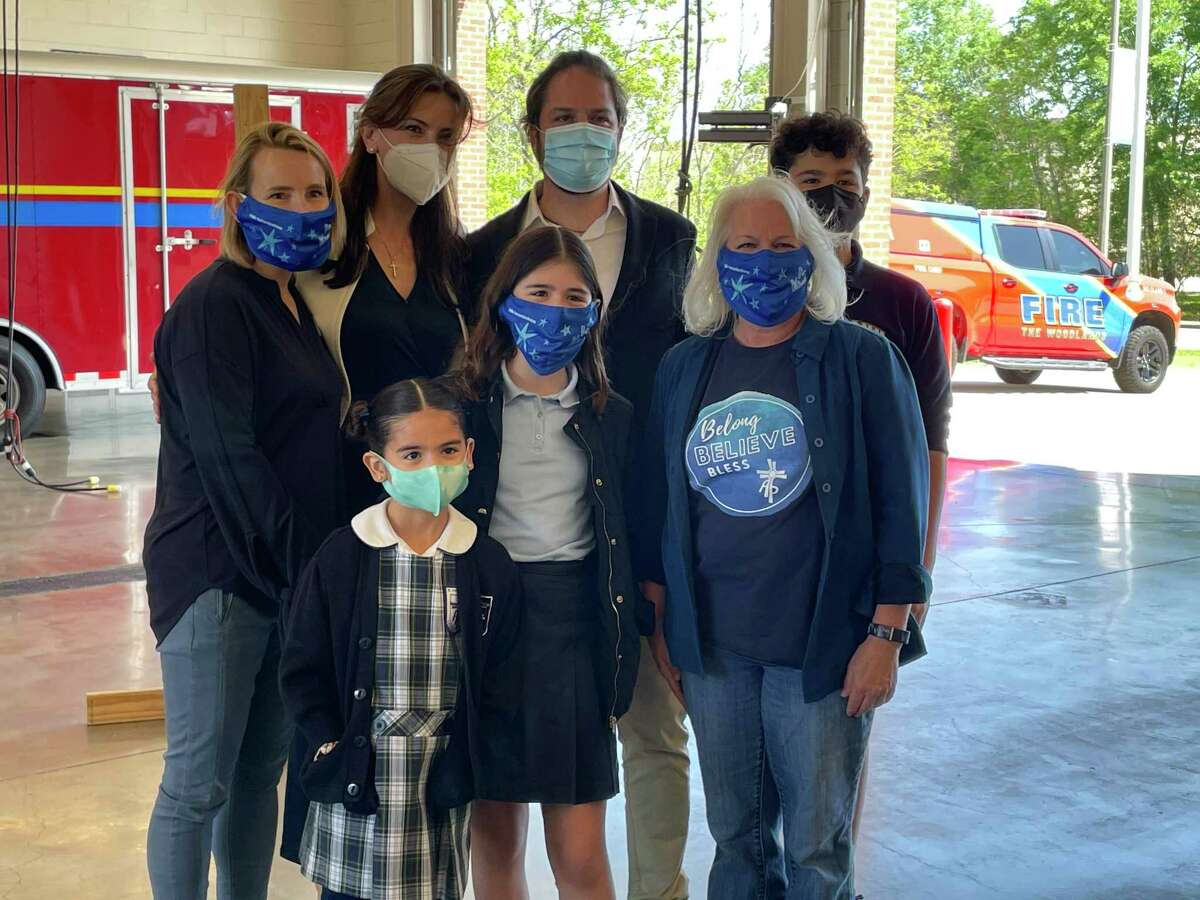 Isabella Del Valle poses with her family after the face mask with a message of kindness she designed was adopted by CHI-St. Luke's as part of a campaign to encourage empathy and respect as well as enhance 'human kindness.' Isabella is a fifth grader at St. Anthony of Padua Catholic School and her mask design will be on face masks distributed to thousands of first responders, teachers, healthcare workers and firefighters and police.
