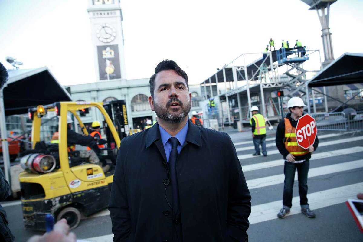 Nathan Ballard, then the spokesman for the Super Bowl 50 host committee, stands along San Francisco's Embarcadero amid Super Bowl City construction in early 2016.
