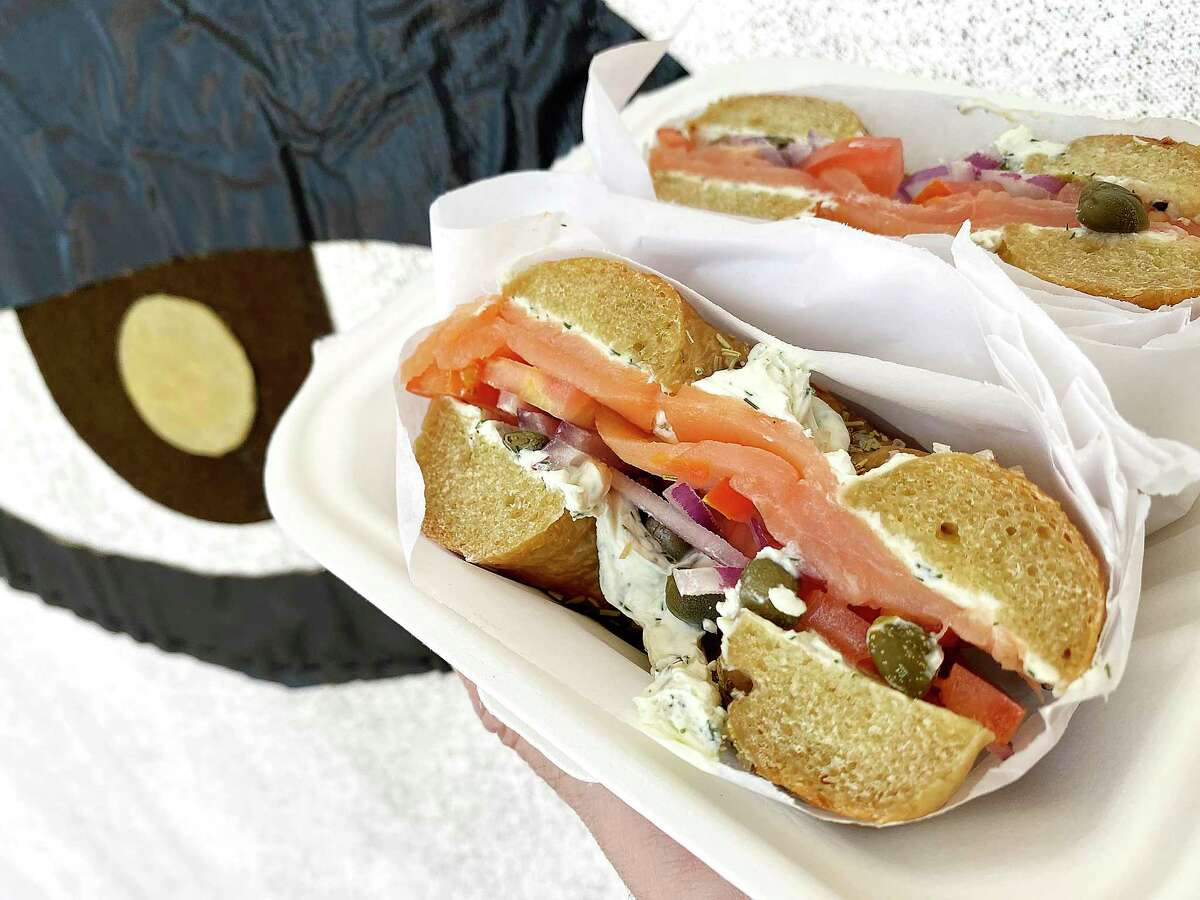 The Lox sandwich includes salmon, lemon-dill cream cheese, capers, red onion and tomato on a rosemary sea salt bagel at Wild Barley Kitchen Co.