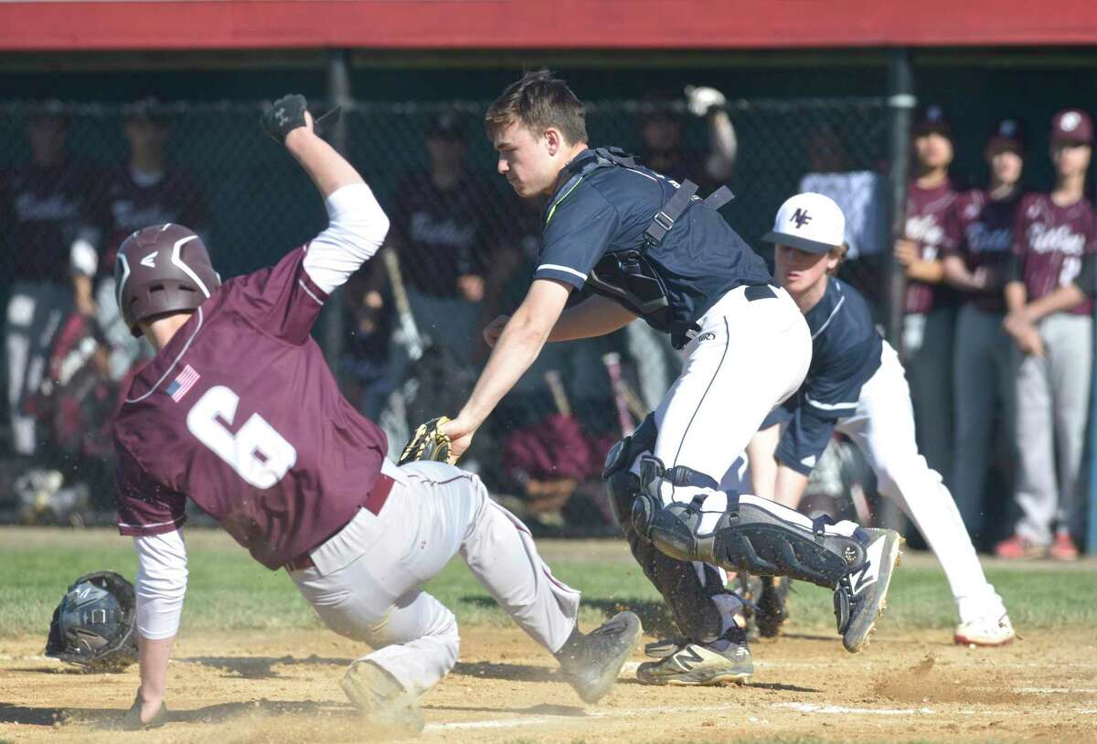 Bethel's Cole Strang (6) slid home, beating Matthew Garbowski's 2019 throw to New Fairfield at New Fairfield.