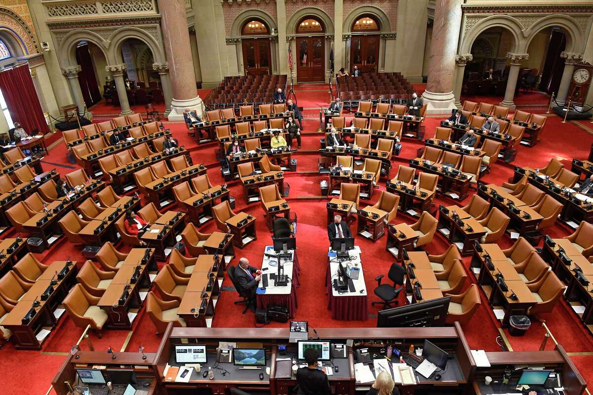 Assembly members vote on the new state budget deal at the Capitol on Wednesday, April 7, 2021 in Albany, N.Y. A three-way deal was reached between the Senate, Assembly and governor on how to spend $212 billion of public money for next year. (Lori Van Buren/Times Union)