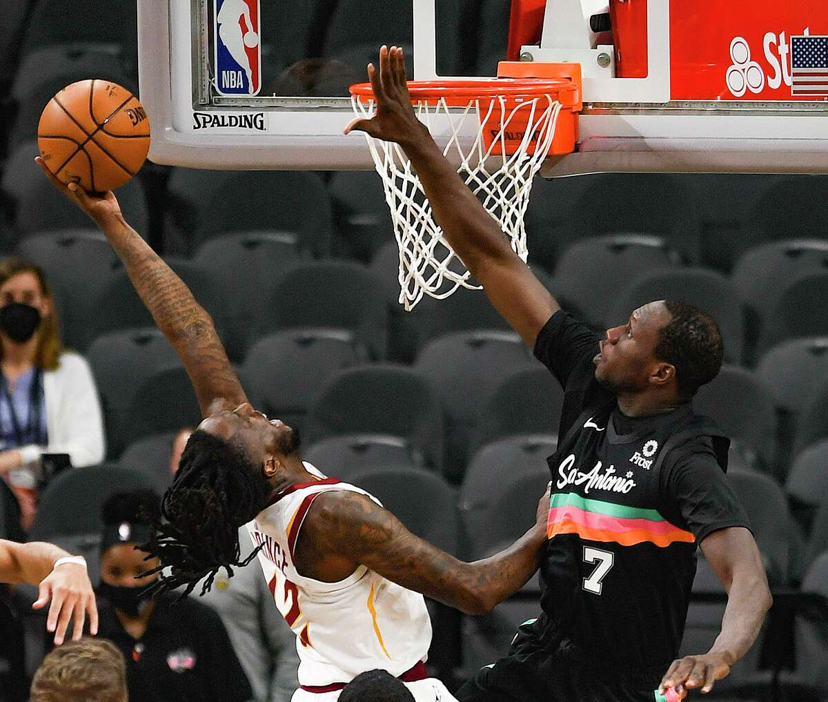 Taurean Prince of the Cleveland Cavaliers shoots as Gorgui Dieng (7) of the San Antonio Spurs defends during NBA action in the AT&T Center on Monday, April 5, 2021.