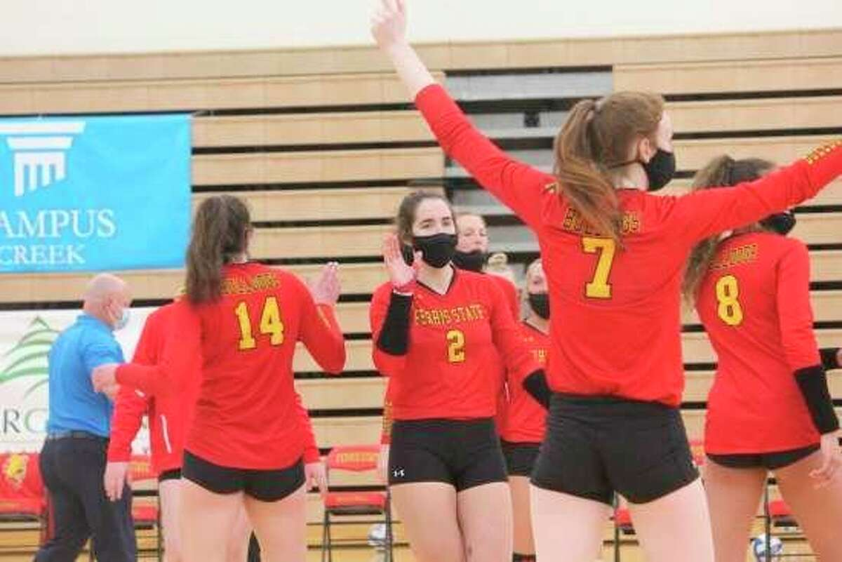 Members of Ferris State's volleyball team celebrate a point during their recent victory over Saginaw Valley State. (Pioneer file photo)