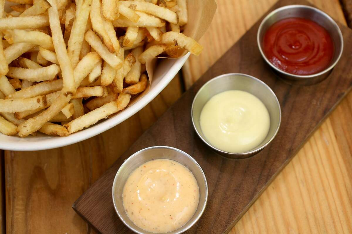 A bowl of fries made from Kennebec potatos and a trio of sauces, (top to bottom) organic ketchup, Basil Aioli and Old Bay Remoulade as served at Starbelly Restaurant on Friday, August 20, 2010 in San Francisco, Calif. While many restaurants across the nation are struggling to keep up with a ketchup shortage, the issue isn't as severe in the Bay Area.