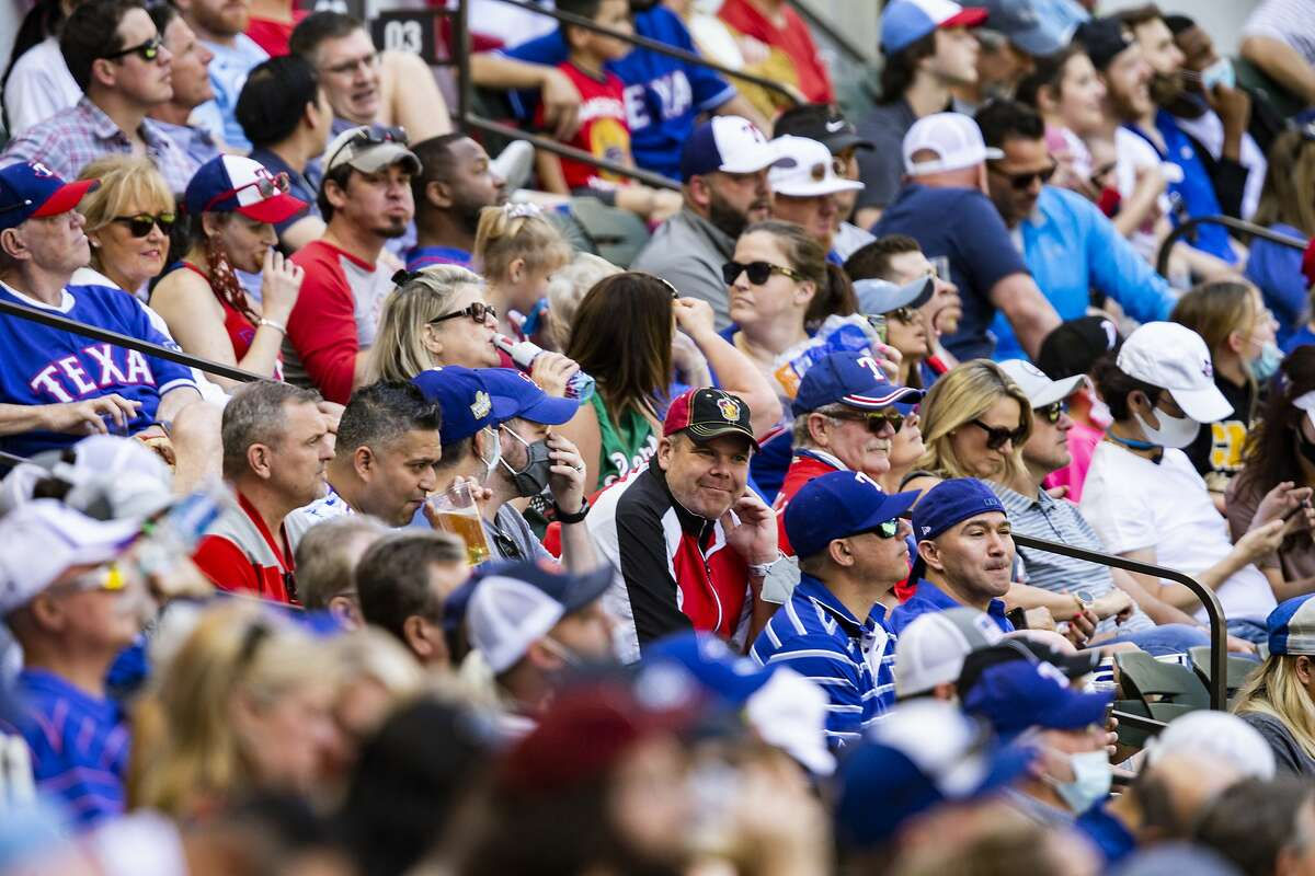 A Rangers-Blue Jays game drew a crowd of 16,876 on April 7, with many of the fans in Arlington, Texas, going maskless.