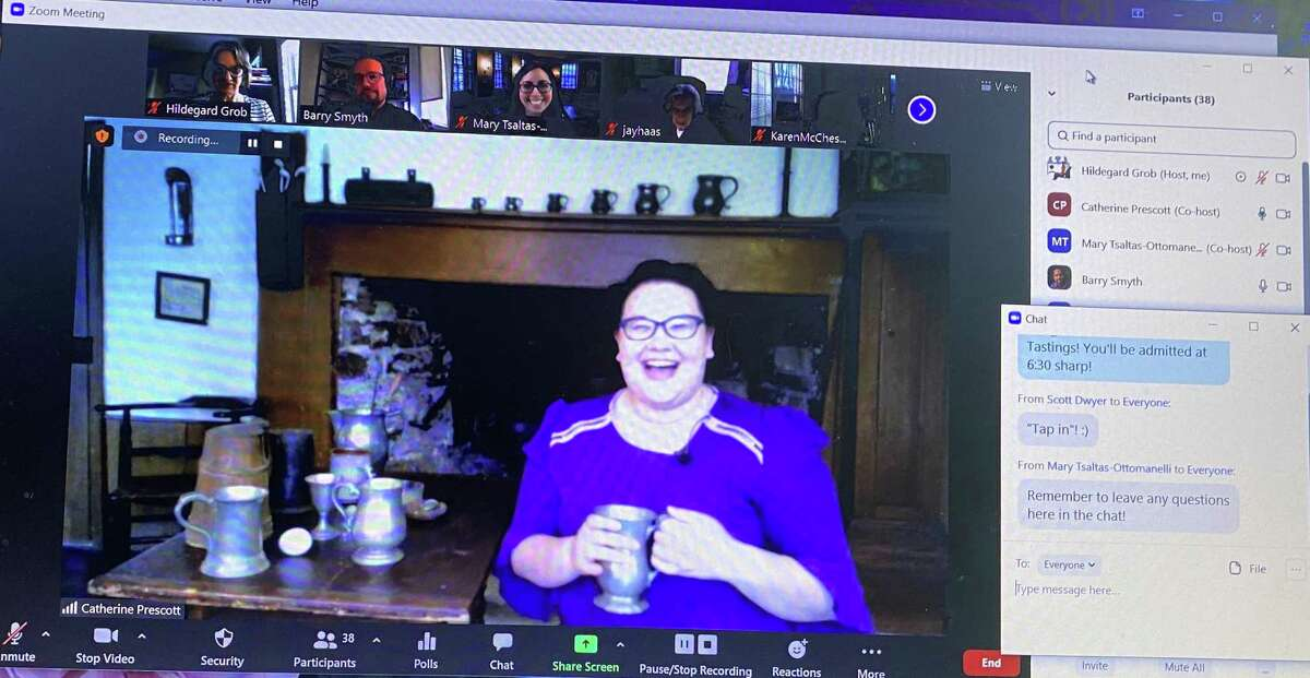 """Keeler Tavern Museum's chief curator Catherine Prescott shows a specialty drink enjoyed at Timothy Keeler's tavern in the 18th century during a virtual """"Tavern Tastings"""" program on April 6, 2021."""