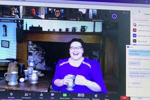"Keeler Tavern Museum's chief curator Catherine Prescott shows a specialty drink enjoyed at Timothy Keeler's tavern in the 18th century during a virtual ""Tavern Tastings"" program on April 6, 2021."